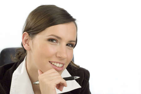likable: Friendly looking young woman with a ballpen in her hand Stock Photo