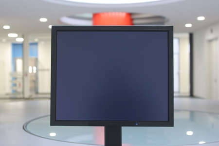 Black screen in the reception hall of a big building