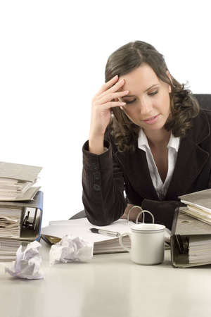 rumple: Young woman sitting at her desktop with folders and papers thinking of problems