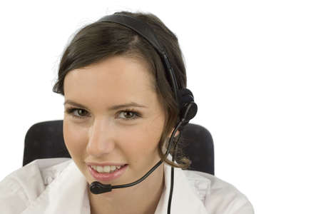 Portrait of a young smiling woman wearing a headset with white background Stock Photo - 692304