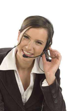telephone saleswoman: Portrait of a young smiling woman wearing a headset with white background Stock Photo