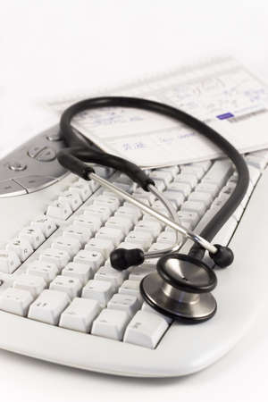 Stethoscope and medical record lying on a keyboard. Focus on the foreground. Stock Photo - 697404