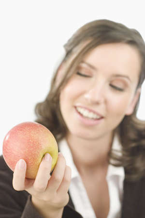 allurement: Young attractive woman with an apple in her hand.