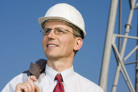 Smiling engineer with white hardhat on construction site Stock Photo - 5611994