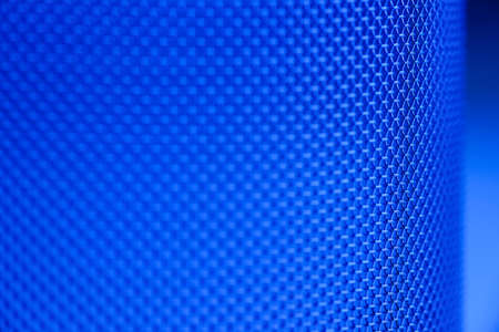 Close-up of a mesh of a sieve in blue - technical background