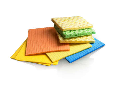 Assortment of various bright means for tidy. Multi color wisp, bast, dishrag and dishcloth for house dust wash mopping. Many rubber and cotton clean scrubber scour. Detail closeup macro view Stock Photo
