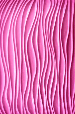 Luxury repeat artsy template in form of solid dune bend shape in plain artistic style with soft shadow. Pastel rose color gesso emboss cement build fond design. Closeup detail view with space for text
