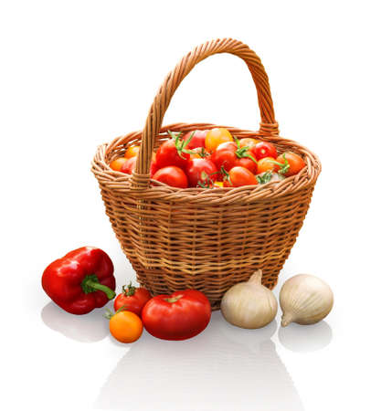Rural still life. Freshly harvested ripe vivid tomatoes of different varieties in wicker basket, onion and pepper on a stump isolated on white backdrop with clipping mask. Close-up view
