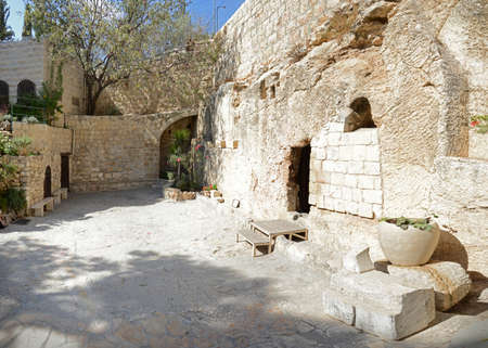 Yerushalayim, Middle East, May 2016. Scenic aged touristic sunny light view of Judea with space for text. Archaic open vacant excavated shrine entombment sepulcher. Famous sacred historic scene