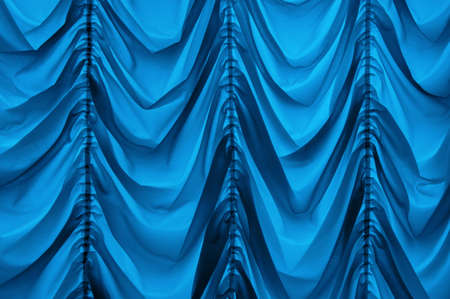 Trendy old fashioned repeating baroque soft satiny wrinkled blinds velum bright navy color with vertical plications. Romantic ancient royalty silky veil sheet design in retro style. Close up view space
