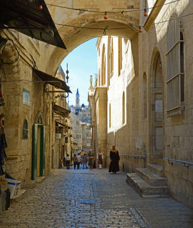 Yerushalayim, Mideast, May 2016. Archaic downtown. Painful Way of Grief, Suffering, Sorrows, last jesus route to crucifixion in passion friday. Scenic aged biblical view and space for text on blue sky