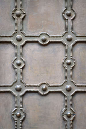 Abstract aged filigreed button rows house fond design. Detailed blank closeup grungy artistic relief tracery with space for text on rough beige color shabby sheet layer in victorian roman luxury style