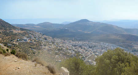 Aerial view from north mount Ari on south agriculture valley with old olive plantations. Middle East. Panoramic scene from lake of Kinneret to Mediterranean Sea and space for text on blue sky backdrop