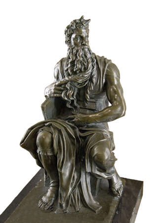 Bronze replica of famous world statuette - figurine Moshe by roman artist Michaelangelo Buonarroti, located in San Pietro in Vincoli basilica, Italy. View close-up isolated on white background Reklamní fotografie - 92290491