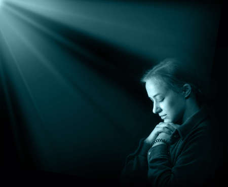 Dramatic evangelical pentecostal pious mourn pretty young light white lady kneeling ask implore wish upwards Jesus Christ. Vintage think life concept copyspace with space for text on dark backdrop