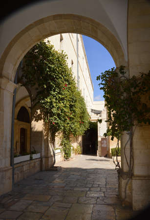 Jerusalem, Middle East, May 2018. Pontius Pilate's Yard Gabatha. Painful Way of Grief Suffering. Last route to crucifixion in passion friday. Scenic aged biblical quarter view. Old franciscan house