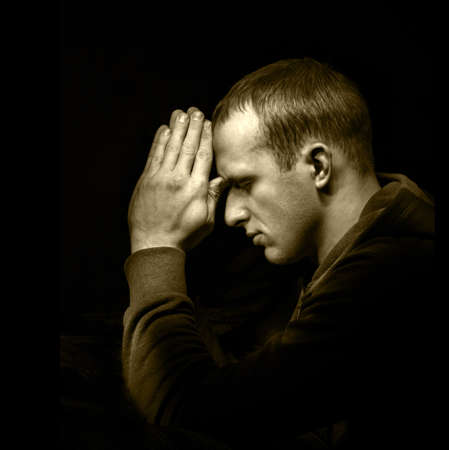 Dramatic orthodox evangelical baptist pious lonely stress mourn young white guy kneeling for ask implore wish upwards Jesus Christ. Modern think concept copyspace with space for text on dark backdrop