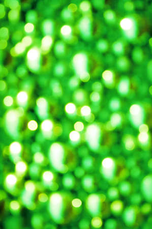 Awe beautiful christmaslight twinkly emerald color dust glitz card copyspace area. Bright glittery de focus art soft sphere shape. Close-up view with space for text on dark merry xmas glowball scene
