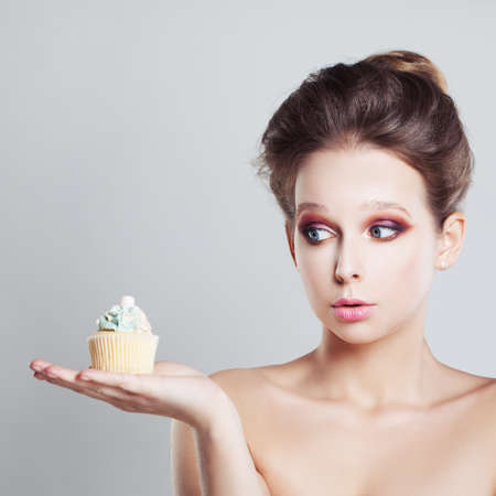 Surprised Woman with Unhealthy Food Stock Photo