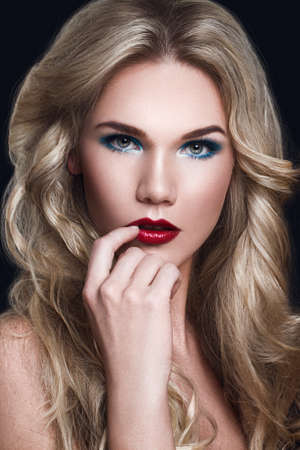 Blonde Model Woman with Long Curly Blonde Hair and Makeup