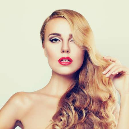 Nice Girl. Cute Face. Long Blond Hair. Closeup Portrait of Sexy Woman