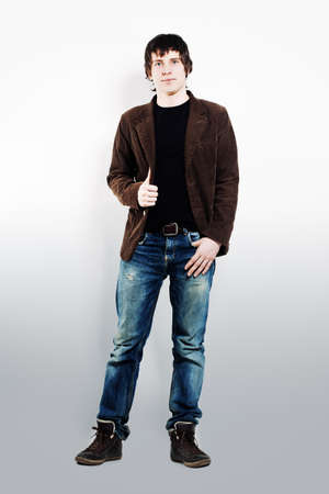 casual men: Young Man Standing on Background