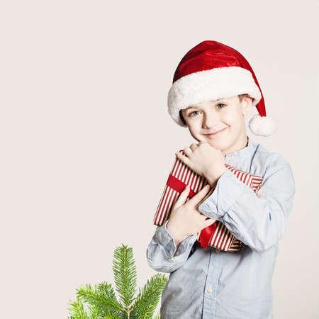 Happy Child Hug Christmas Gift Box. Xmas Happiness Concept Stock Photo