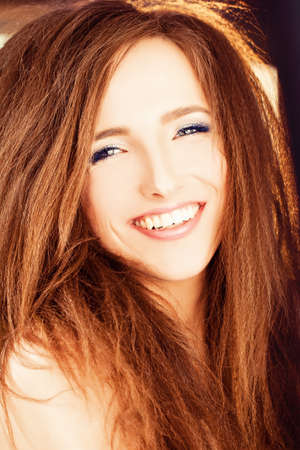 uncombed: Smiling Woman with Red Hair Stock Photo