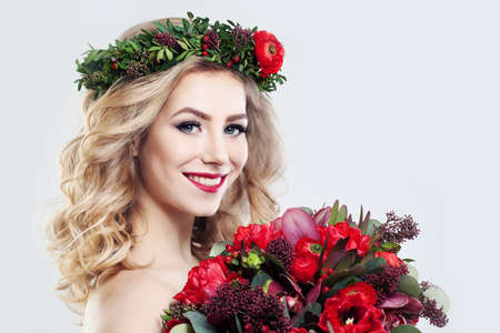 womens hands: Beautiful Woman Fashion Model with Flowers Bouquet Stock Photo