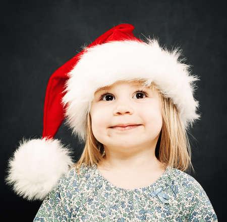 fondo para bebe: Happy Child in Santa Hat Smiling Foto de archivo