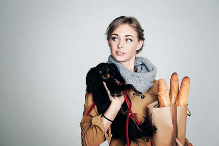 french woman: French Woman with Small Dog and Baguette on Background with Copy Cpace