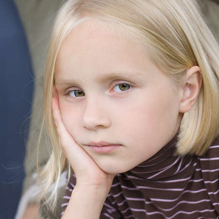 Sad teen girl face close-up