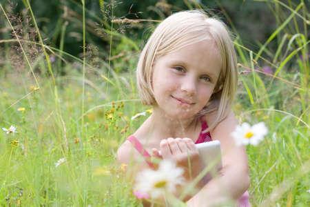 Cute girl with e-reader outdoor