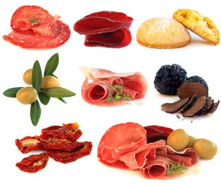 Italian cuisine, gourmet food, antipasti - prosciutto; salame, truffle, olive and sun-dried tomato isolated Stock Photo