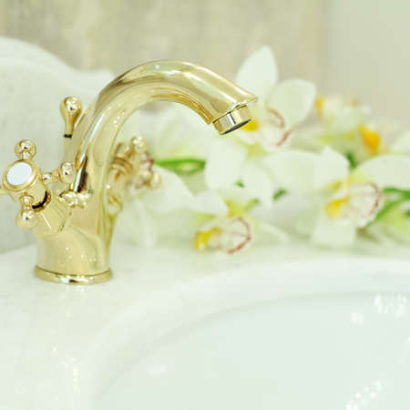bathroom tiles: Bathroom Interior - sink and faucet closeup, background (shallow depth of field)