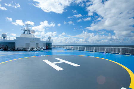 heliport: Ship, heliport and sky with clouds Stock Photo
