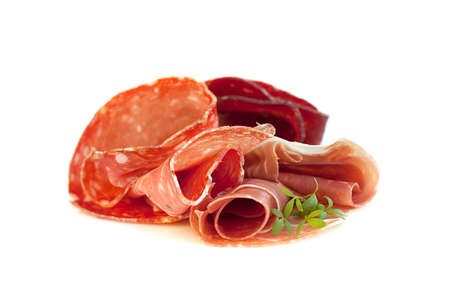 Italian cuisine, gourmet food - prosciutto and salami sausage isolated