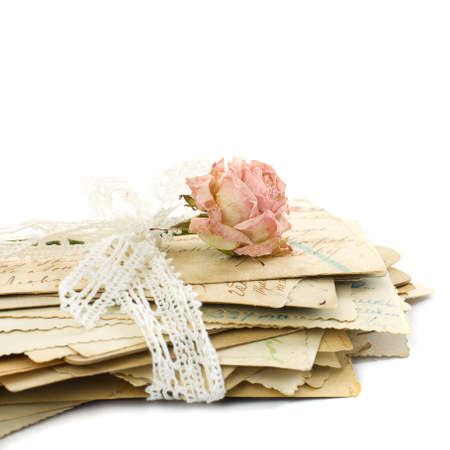 Stack of old love letters (1890-1910), lace and rose flower Standard-Bild