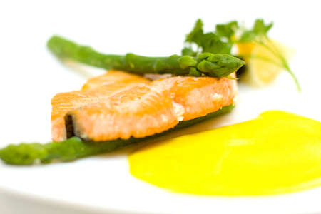 Salmon and aspargus shot with lemon, dill garnish with shalow depth of field