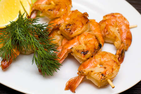 Grilled shrimp with dill and lemon Stock Photo