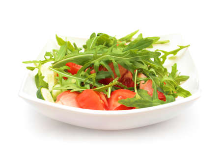 roquette: Salad from tomatoes, rucola, pepper, olive oil on white plate