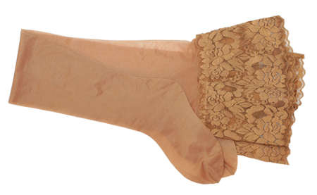 Paare der beige Strümpfe getrennt auf Weiß