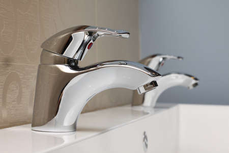 faucet and sink - modern bathroom close-up Stock Photo