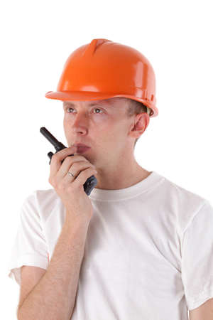 cb phone: builder talking on portable UHF radio transceiver isolated on white