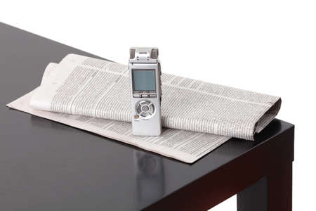 News gathering. Background with dictaphone and newspaper