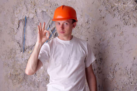 approx: Work electrician shows approx - ok. Job well done Stock Photo