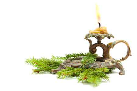 candlestick: Old candlestick with Christmas fir branch