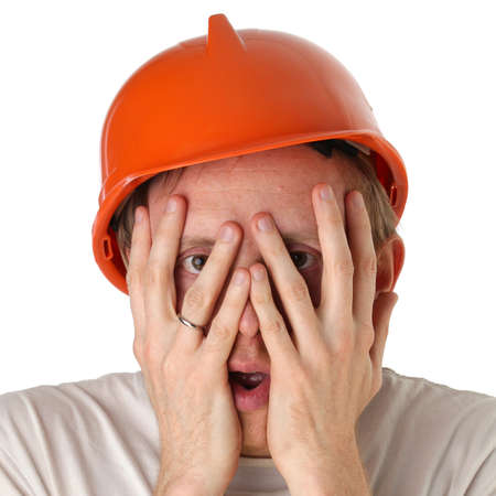 Shocked and surprised builder craftsman isolated on a white background Stock Photo