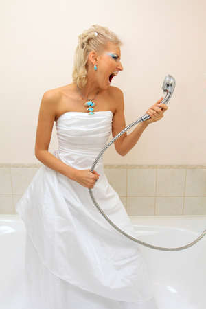 cries: Fashion model in wedding dress cries in the bathroom Stock Photo