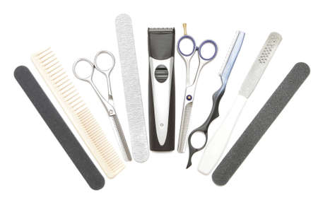 Professional hairdressing, manicure and pedicure tools. Comb, clip, file, scissor, clippers, tweezer and hair trimmer isolated on white background